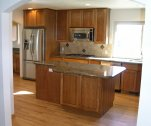 Cherry cabinets with black canyon tops