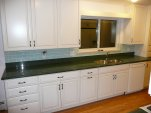 White glazed maple cabinets with absolute green tops 2